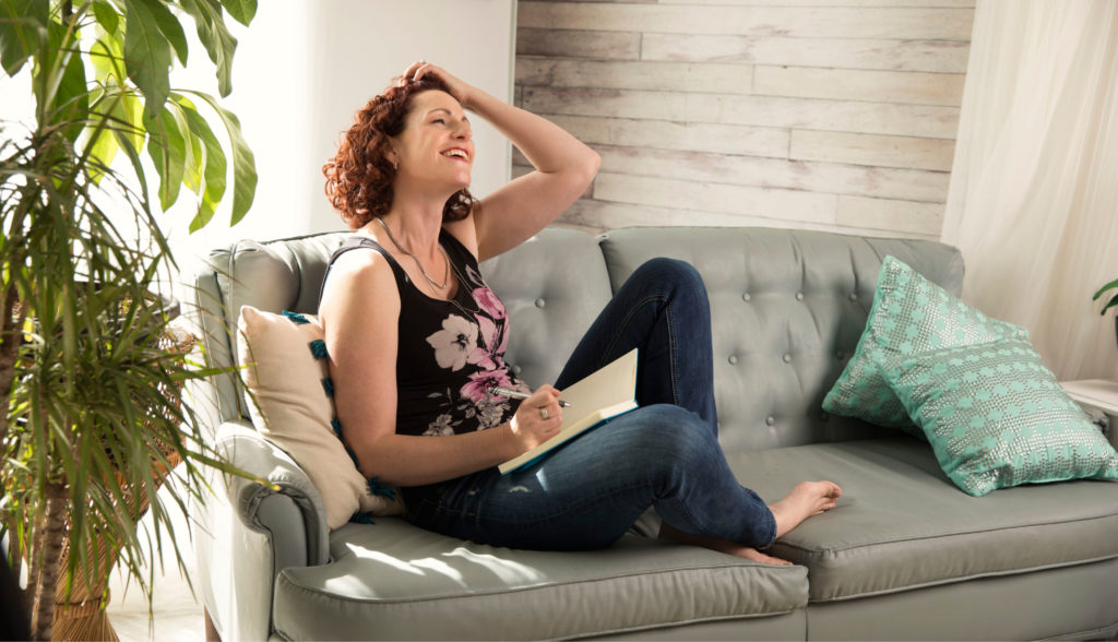 Dorothy Villeneuve Women's Sales Confidence Coach Sitting with Laptop